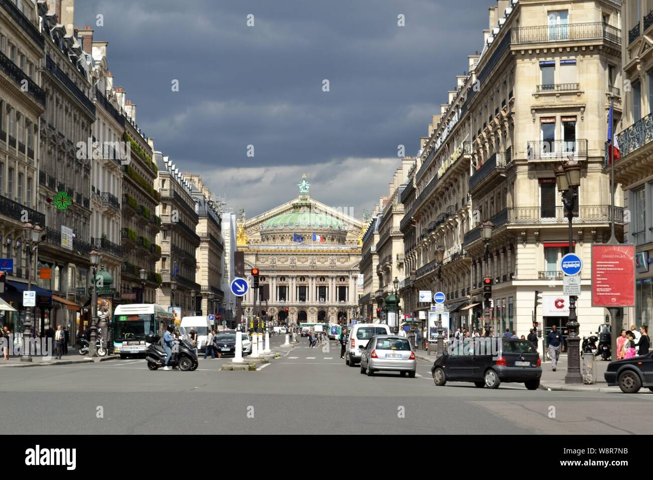 Paris/France - August 19, 2014: View to the Opera de Paris at the end of the Avenue de l'Opera illuminated by the sun before the storm. Stock Photo