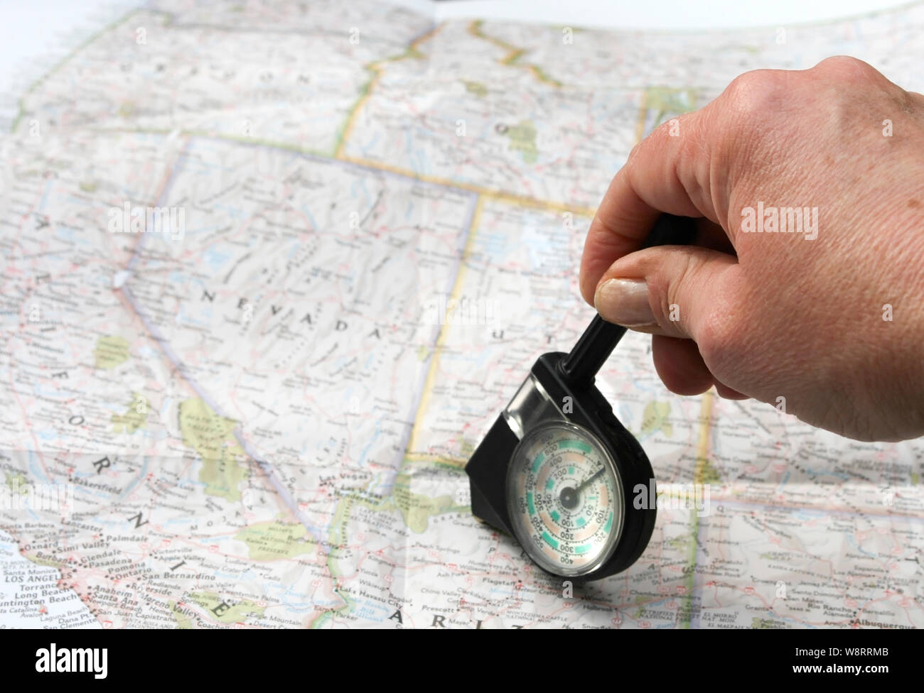 Hand with distance calculator on route map of west usa Stock ...