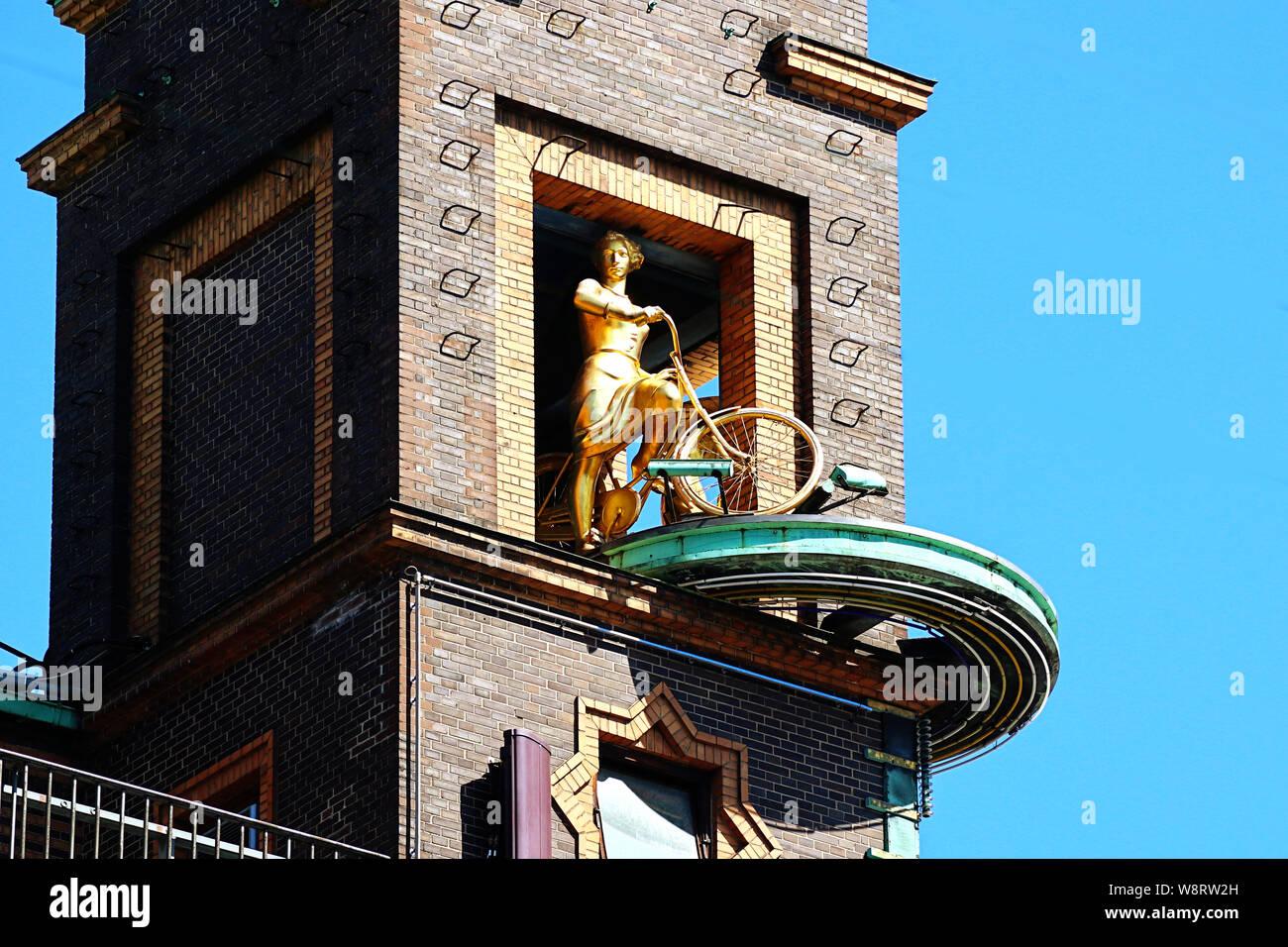 COPENHAGEN, DENMARK - JUNE 14, 2019 Copenhagen, Radhuspladsen: the weather girl a golden sculpture torating group telling the weather: the girl with t Stock Photo