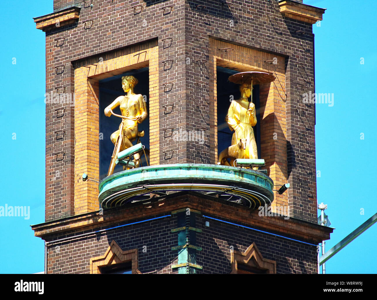 COPENHAGEN, DENMARK - JUNE 14, 2019 Copenhagen, Radhuspladsen: the weather girl, a golden sculpture rotating group telling the weather: the girl with Stock Photo