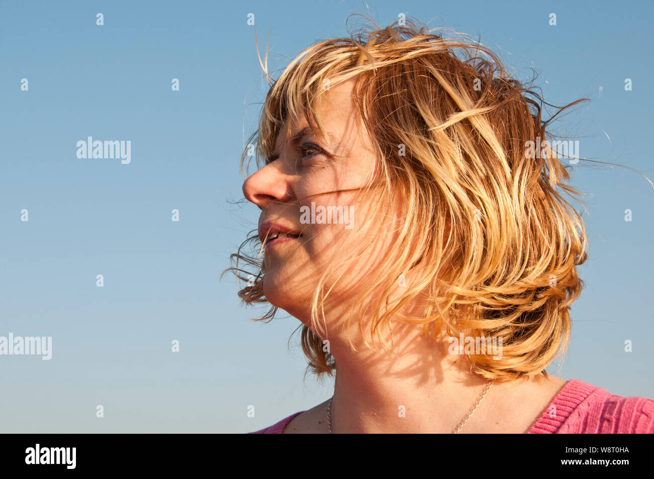 portrait of an optimistic blonde woman in her forties Stock Photo