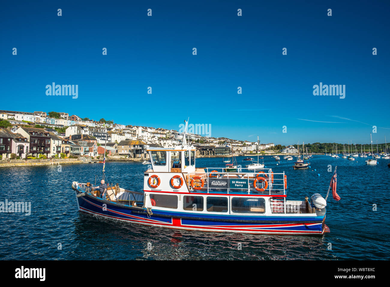 The Falmouth to St Mawes ferry on River Fal estuary with Falmouth to the rear. Cornwall, England, UK. Stock Photo