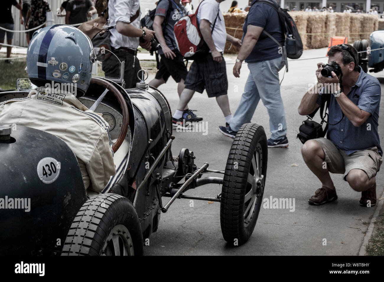 1931 Bugatti Type 35C waiting to go out on the hillclimb at the 2019 Goodwood Festival of Speed, Sussex, UK. Passing spectators and photographer. Stock Photo