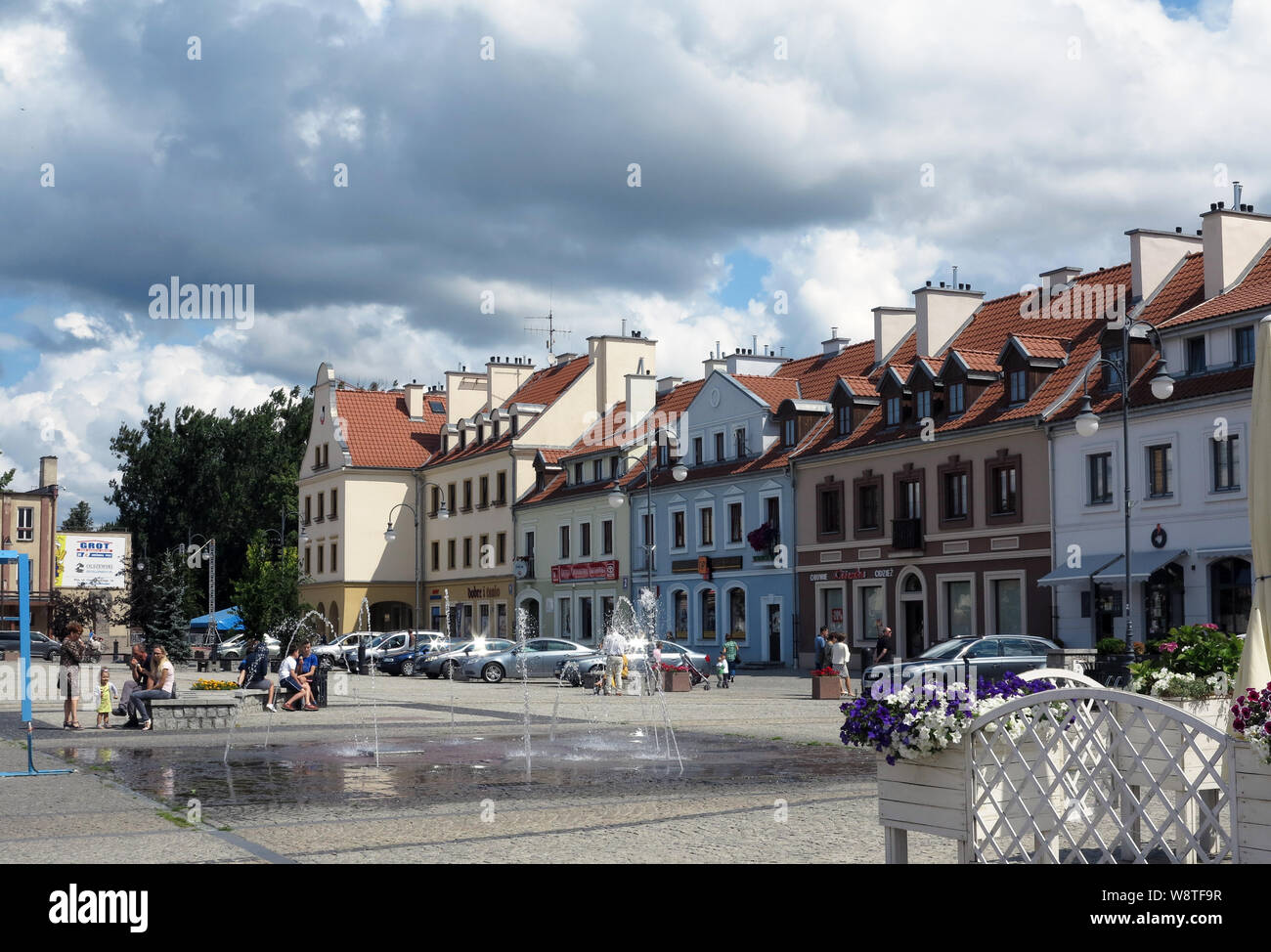 Restored civil houses from the pre-war period at the market of Pisz (Johannisburg) in the Polish Masuria (former East Prussia), recorded on 14.07.2019 | usage worldwide Stock Photo