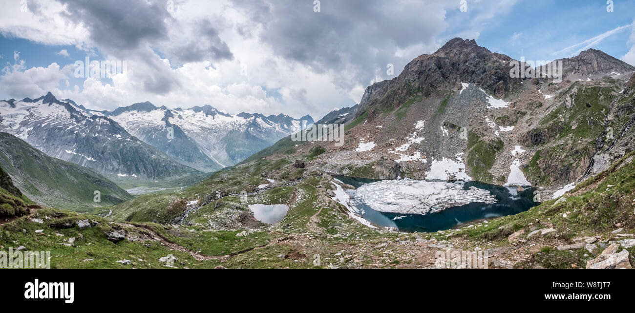 Schwartz See alpine lake located near the Berliner Hut in the Zillertal Alps and the resort town of Mayrhofen in the mountains of the Austrian Tirol Stock Photo