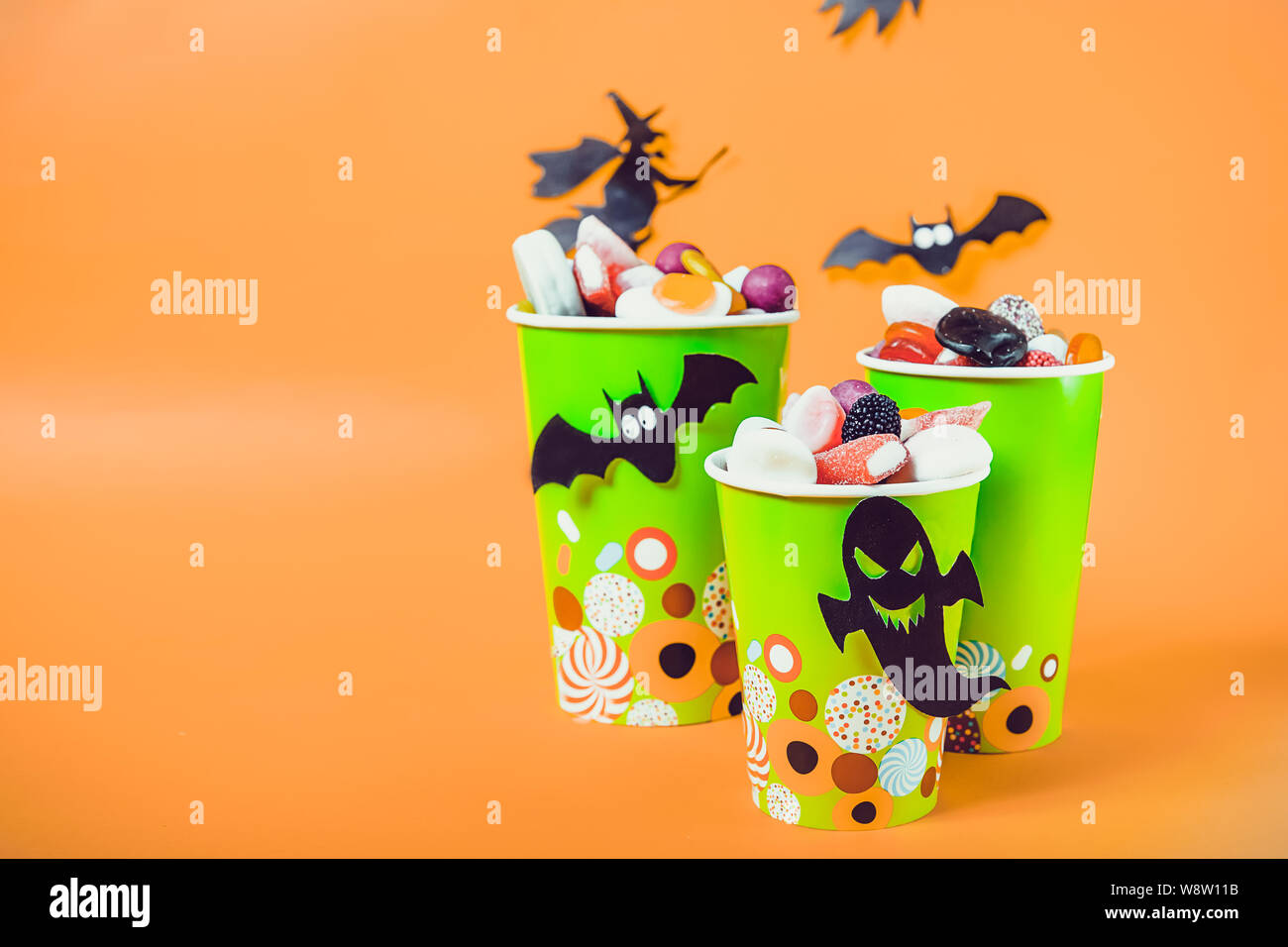 Halloween Trick Or Treat Silhouette.Halloween Trick Or Treat Sweets Paper Cups With Colourful