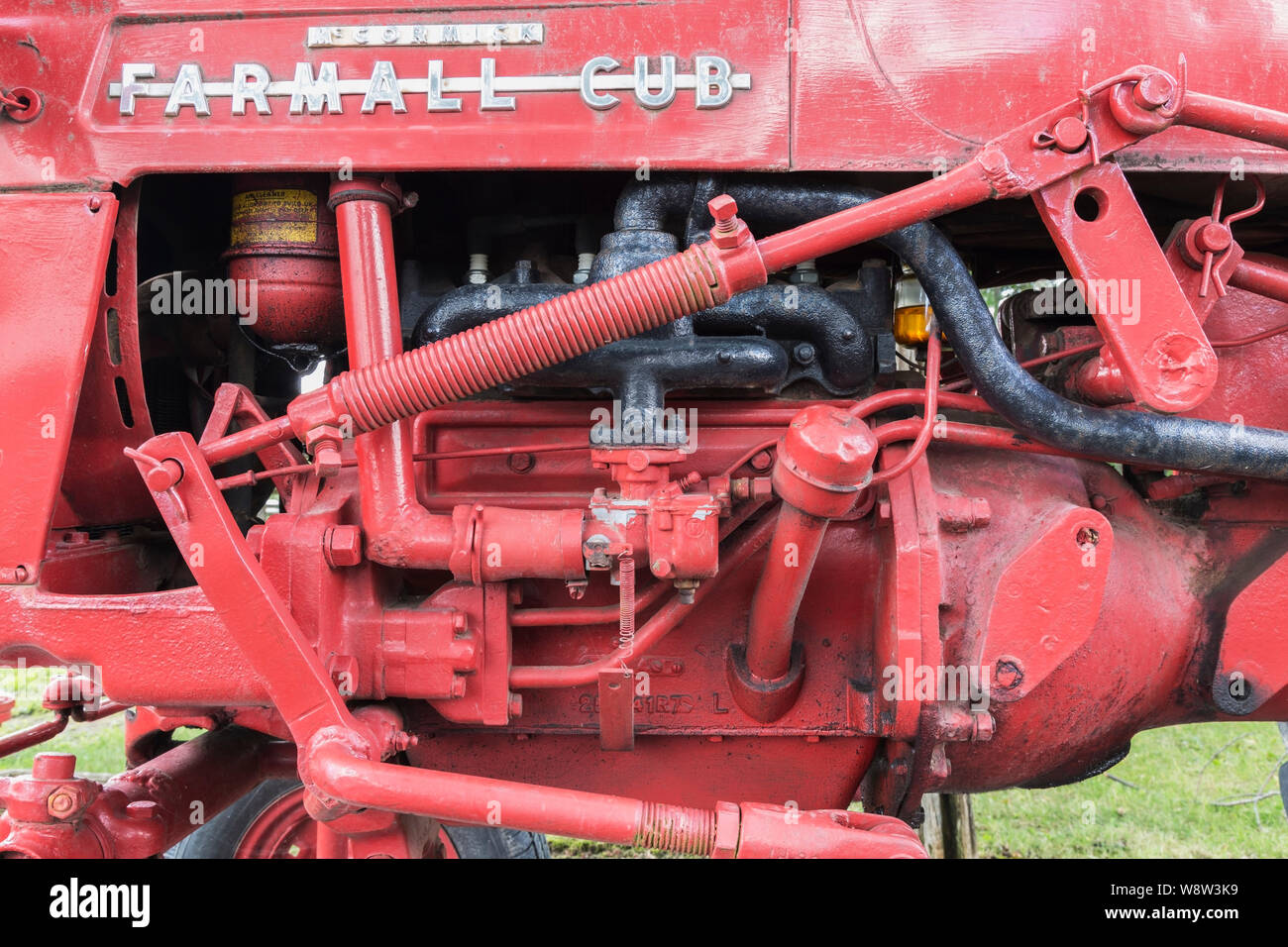Close-up of old red painted McCormick Farmall Cub tractor