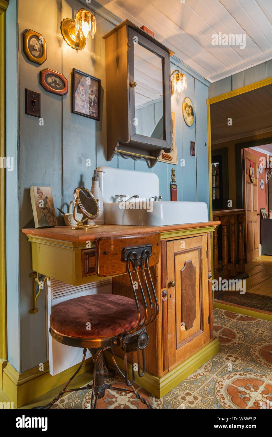 Wash Sink Cabinet With Makeup Table And Chair In Upstairs Main Bathroom With Florentine Ceramic Tile Floor Inside Old 1835 Canadiana Home Stock Photo Alamy