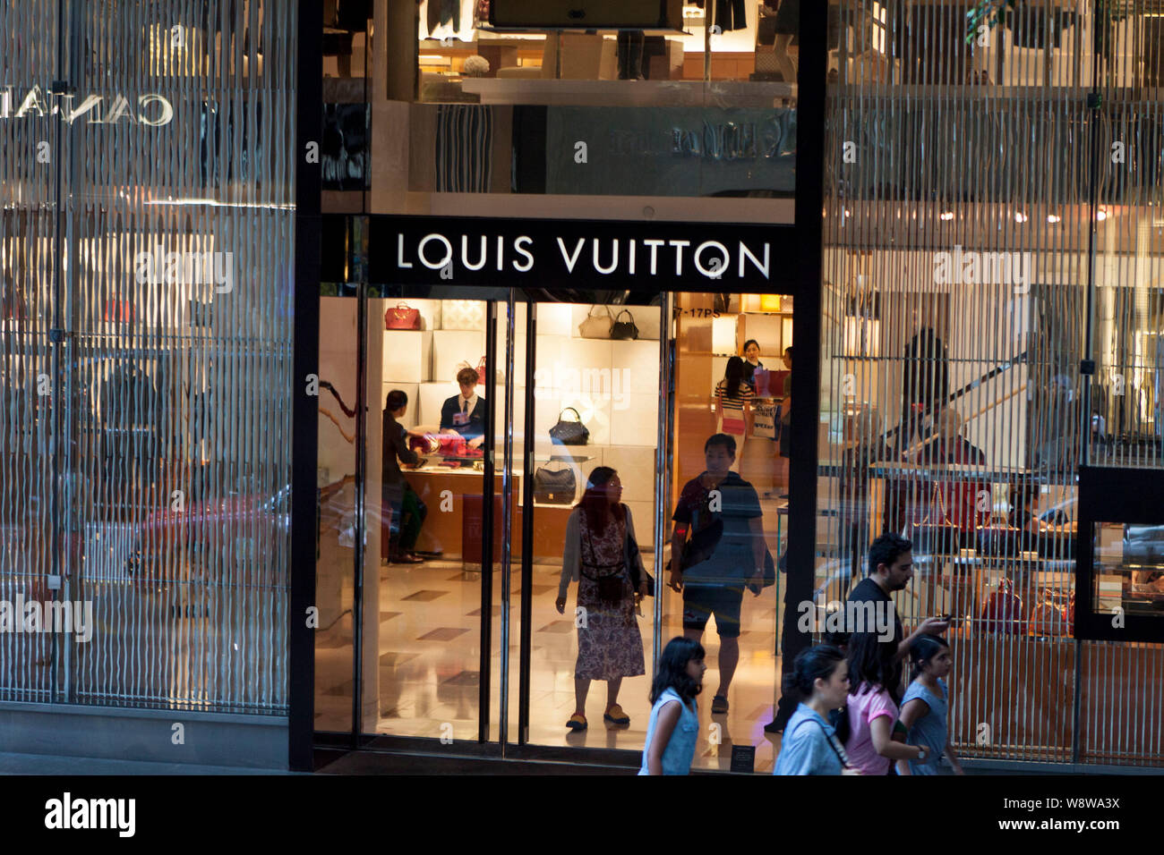 ad8657254ce A Louis Vuitton Shop Stock Photos & A Louis Vuitton Shop Stock ...