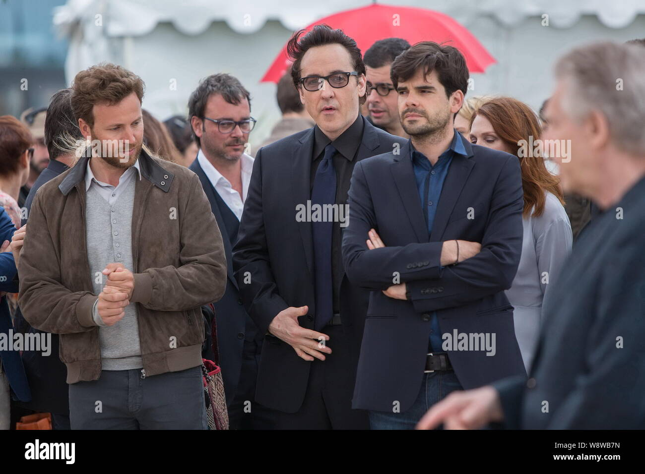 American actor John Cusack, center, poses at a photocall for ... on trip map, space map, war map, princess map, fun map, statue map, portrait map, adventure map, musical map, animation map, 9gag map, action map, media map, water map, dual screen map, game map, novel map, right to die map, seaworld gold coast map, business map,