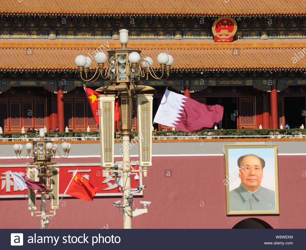 Chinese and Qatari national flags flutter on lampposts in front of the Tiananmen Rostrum during the visit of Qatar's Emir Sheikh Tamim bin Hamad al-Th Stock Photo