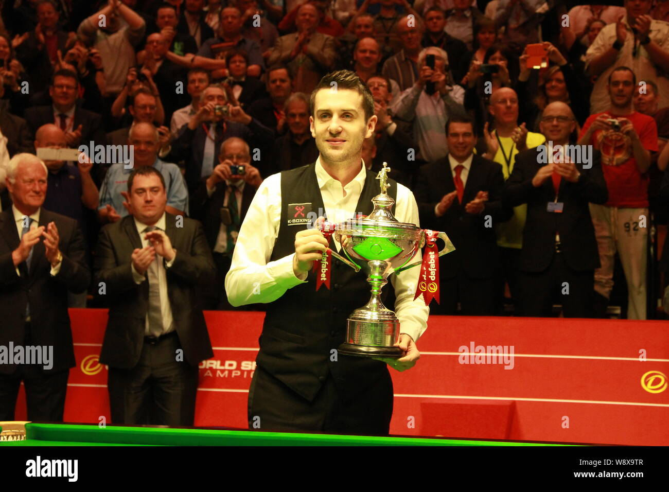 Mark Selby of England poses with his champion trophy after ...