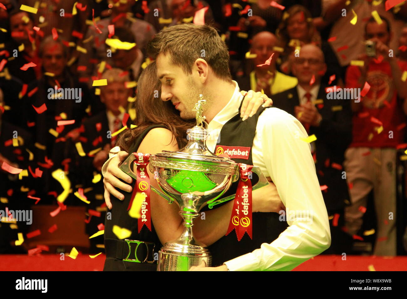 Mark Selby of England, right, hugs his wife Vikki Layton to ...