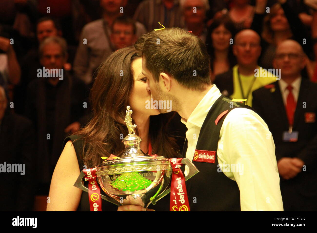 Mark Selby of England, right, kisses his wife Vikki Layton to ...
