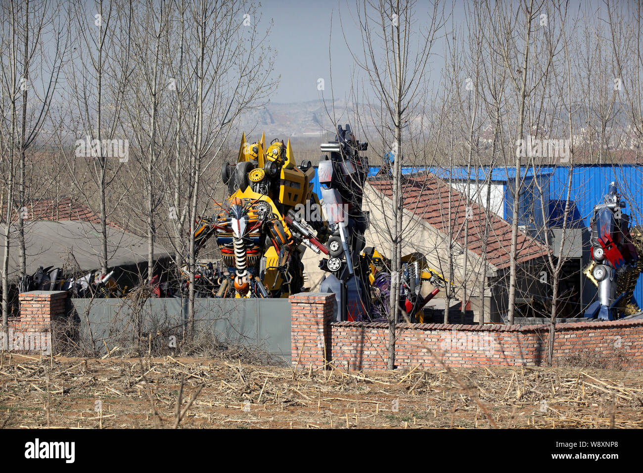 Replicas of Optimus Prime and Bumblebee, tallest two, from the movie series, Transformers, and other robots made from scraps of vehicles are seen on d Stock Photo