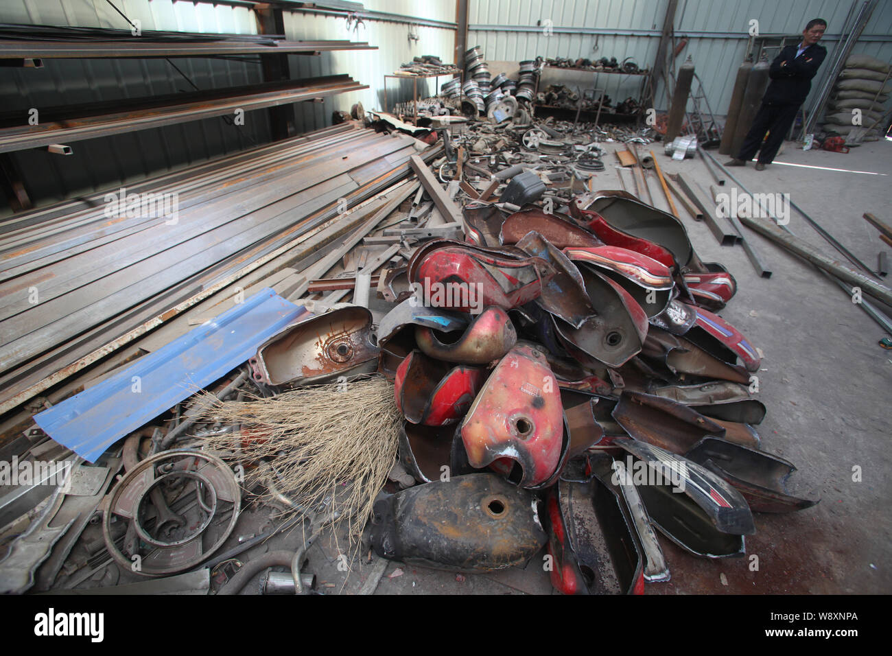 Scraps of vehicles for making robots are seen at a workshop in Shengjing town, Zhangqiu, Jinan city, east Chinas Shandong province, 21 March 2014.   A Stock Photo