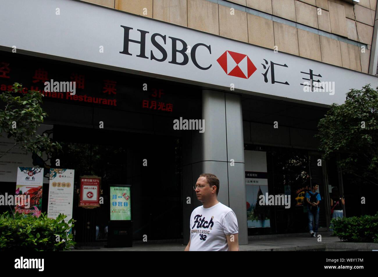 FILE--A pedestrian walks past a branch of HSBC (the Hongkong