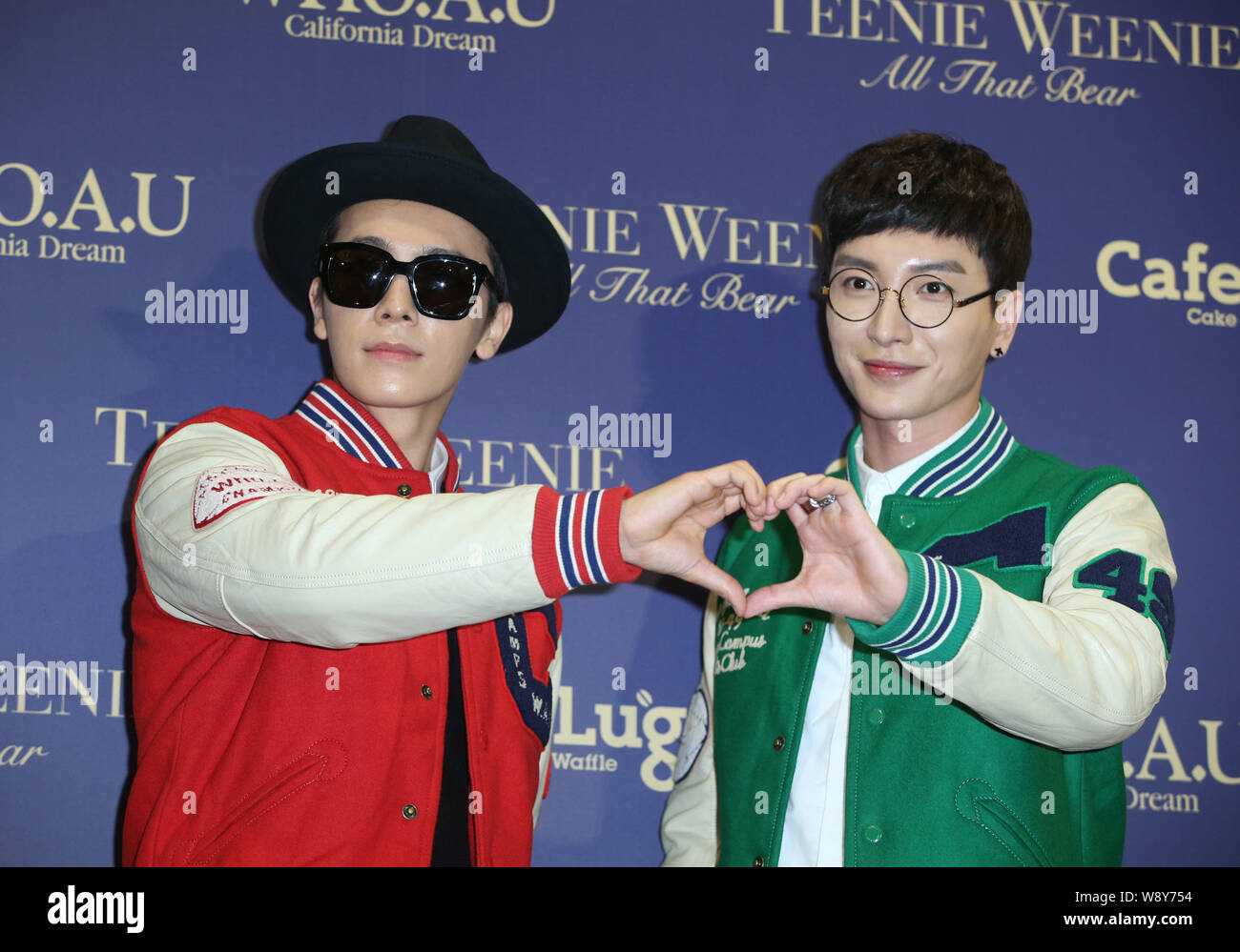 Lee Donghae Left And Lee Teuk Of South Korean Pop Group Super Junior Pose During An Opening Ceremony For A New Clothes Store In Taipei Taiwan 3 S Stock Photo Alamy