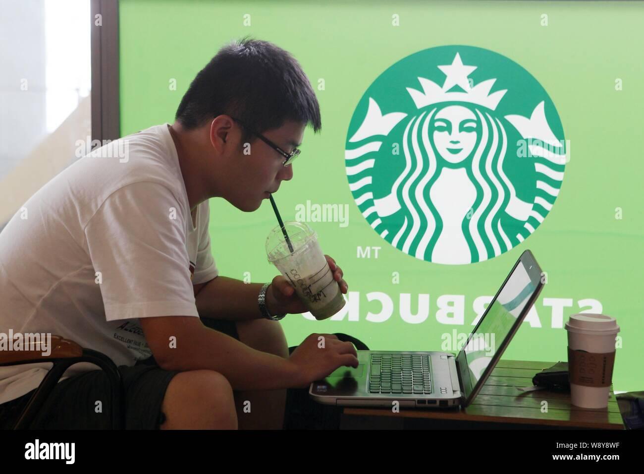 file-a-customer-drinks-coffee-as-he-uses