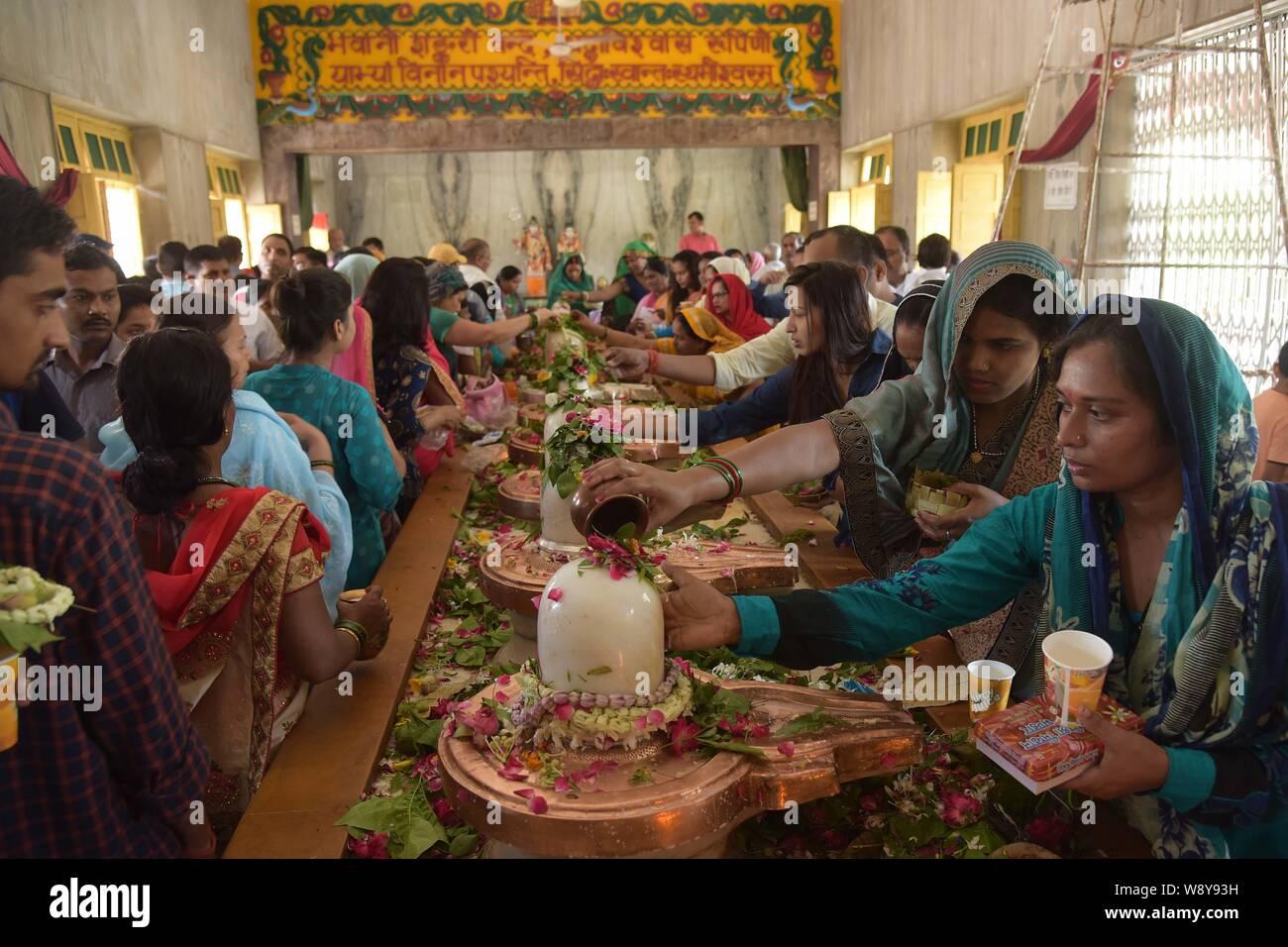 August 12, 2019: Prayagraj: Hindu Devotee offer prayer to