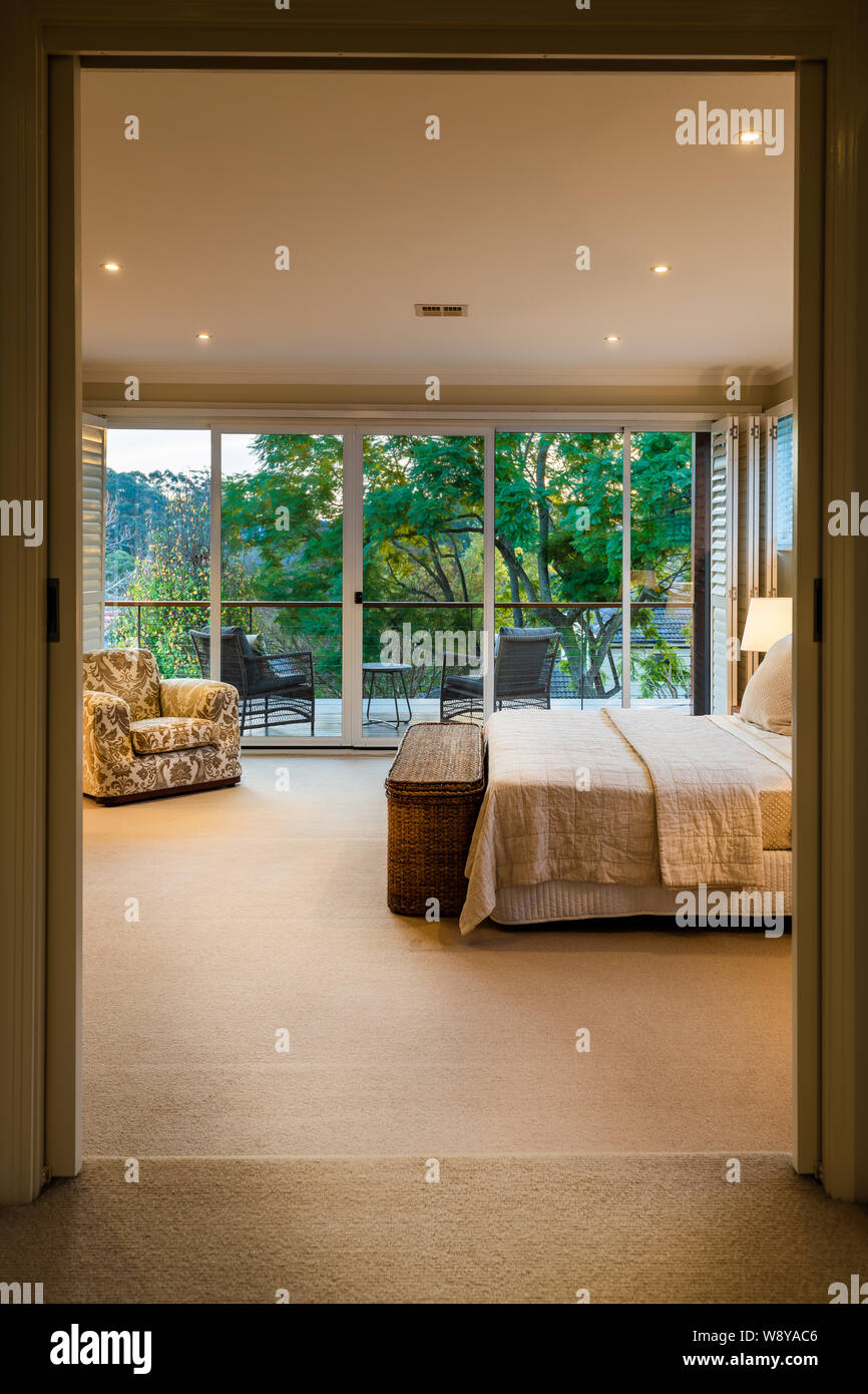 Modern Luxury Master Bed Room With Bed Side Tables Lamps Down Lights And Walk In Robe Real Estate Stock Photo Alamy