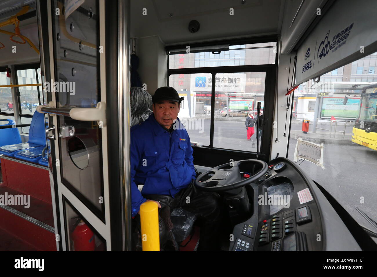 A shield door is equipped on a bus to protect bus drivers