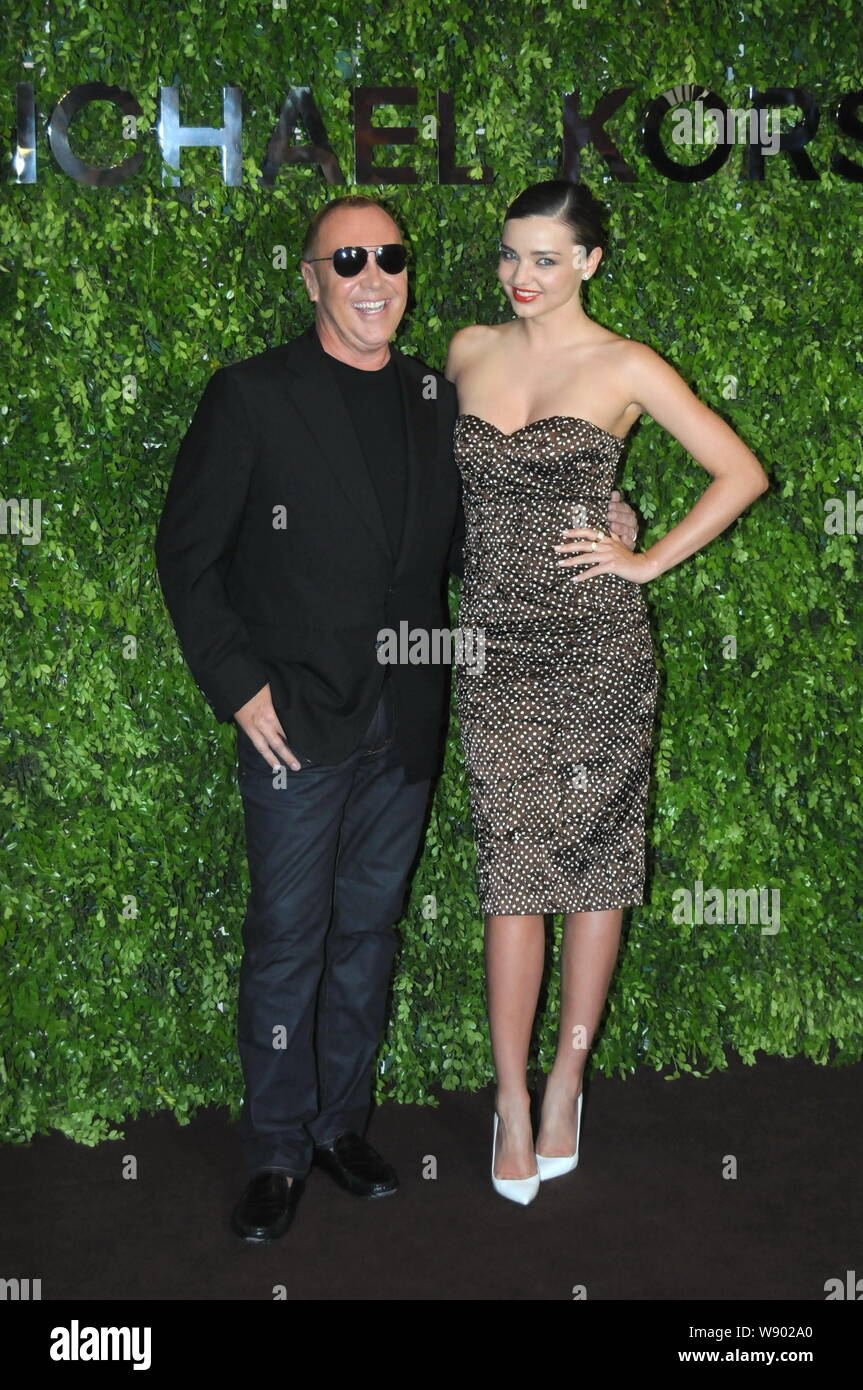 Australian Model Miranda Kerr Right Poses With American Fashion Designer Michael Kors During The Opening Ceremony For The Flagship Store Of Michael Stock Photo Alamy