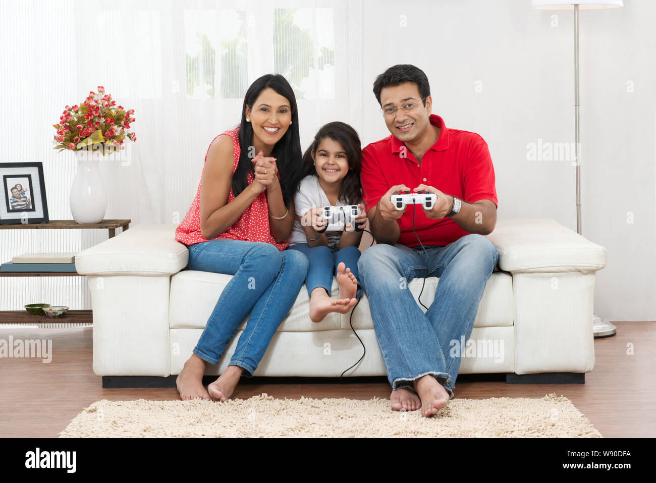 Family Playing Video Game At Home Stock Photo Alamy