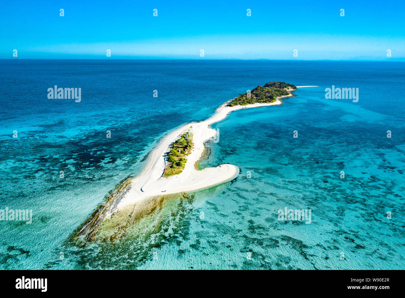 Truly amazing tropical island in the middle of the ocean. Aerial view of an island with white sand beaches and beautiful lagoons Stock Photo