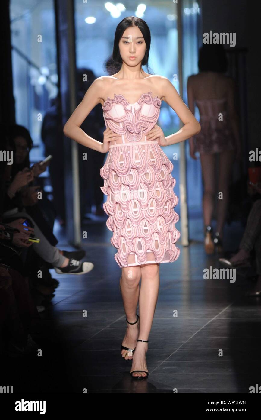 A model displays a new creation by Chinese fashion designer Qiao Qi at the Georgette Qiaoqi fashion show during the China Fashion Week Fall/Winter 201 Stock Photo