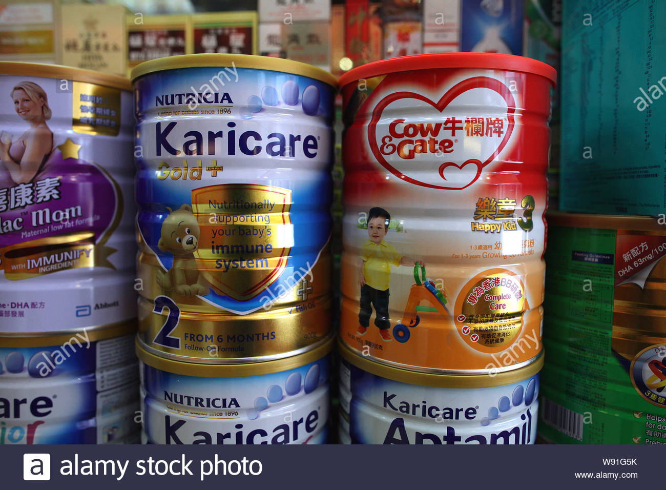 Tins of Cow & Gate and Nutricia Karicare baby formula of