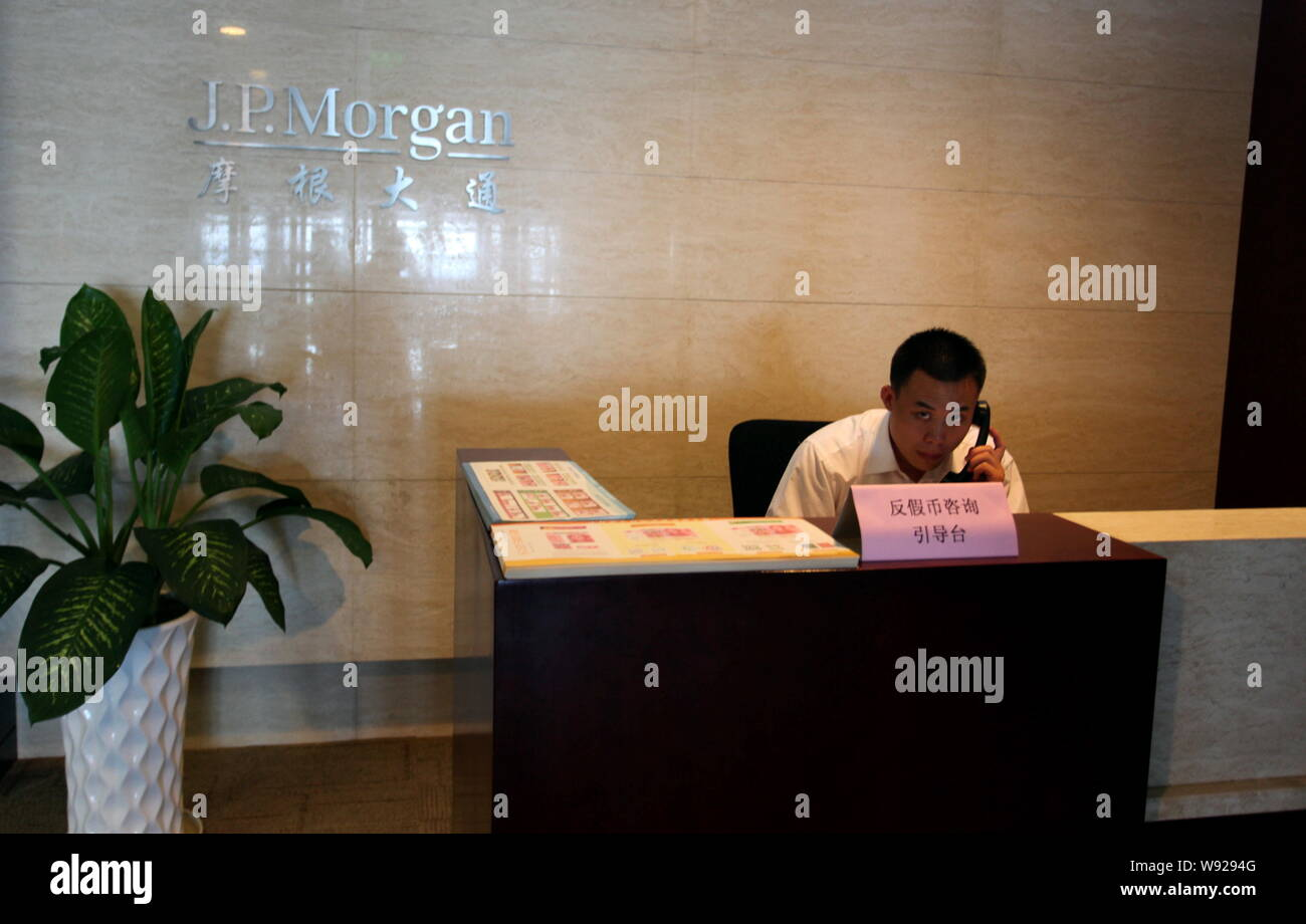 --FILE--A Chinese employee works at a branch of JP Morgan in Suzhou city, east Chinas Jiangsu province, 21 July 2012.   J.P. Morgan Chase & Co. has wi Stock Photo