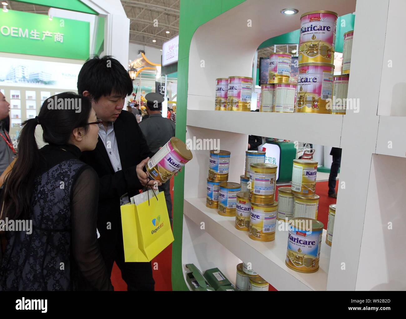 FILE--Chinese visitors check the ingredients of imported