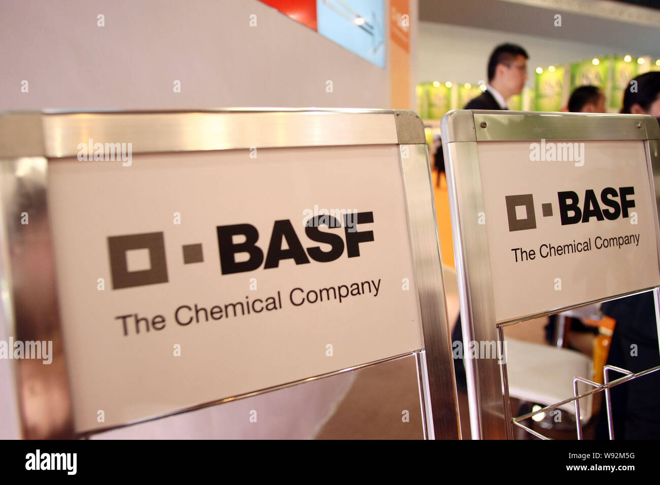 FILE--People visit the stand of BASF, the German chemical