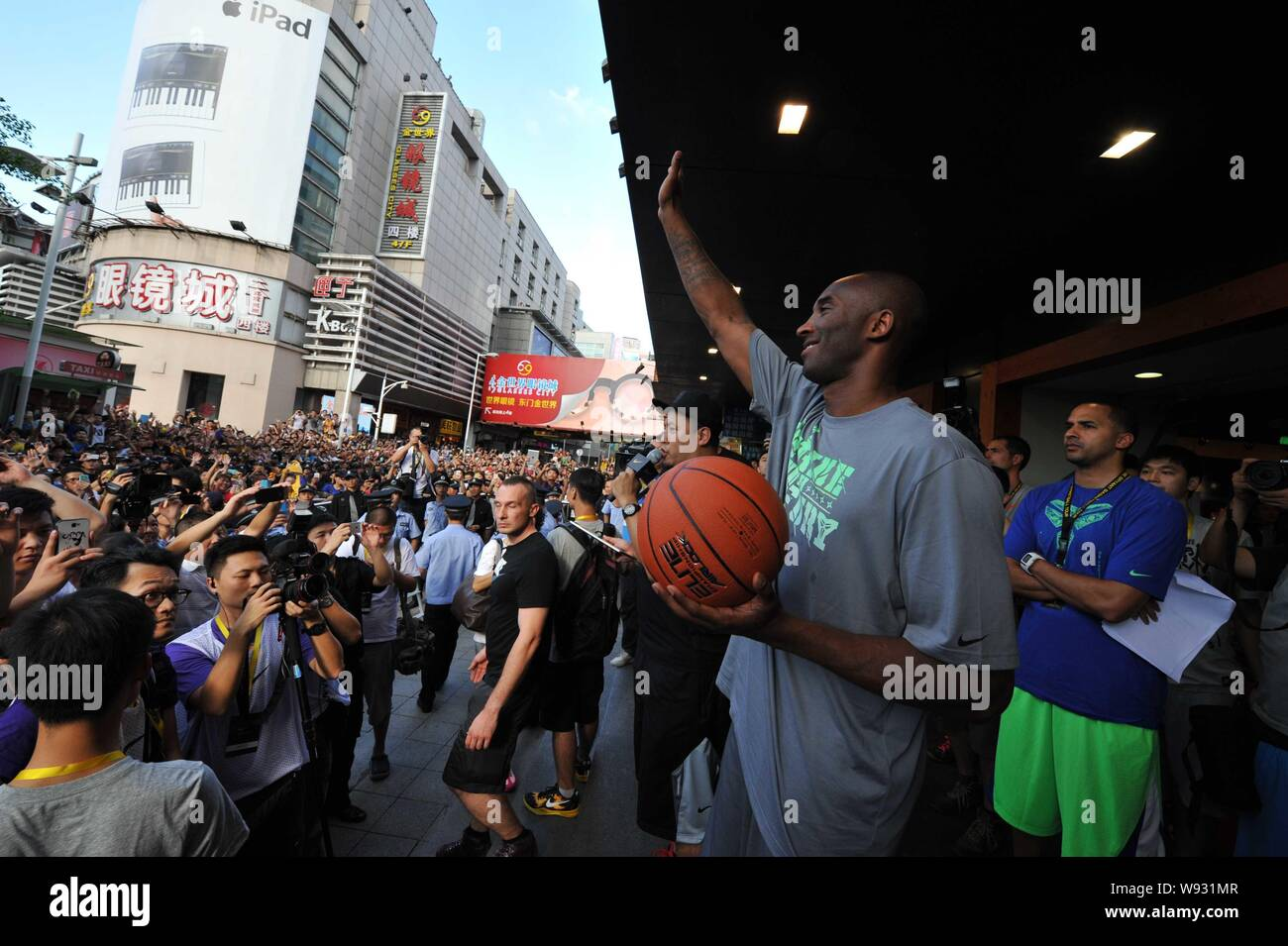 size 40 877c0 c186f NBA star Kobe Bryant, front, waves to a crowd of fans during ...