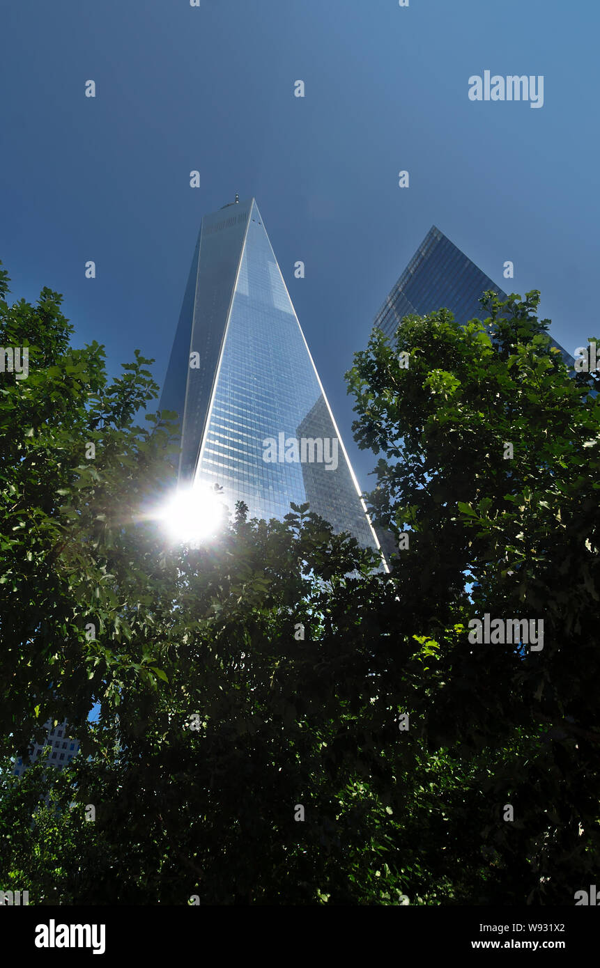 One World Trade Center reflected the sun, in downtown Manhattan, New York. Stock Photo