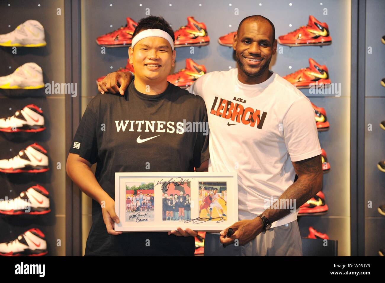 new concept 7e5c0 7fb82 NBA superstar LeBron James, right, poses with a fan during a ...