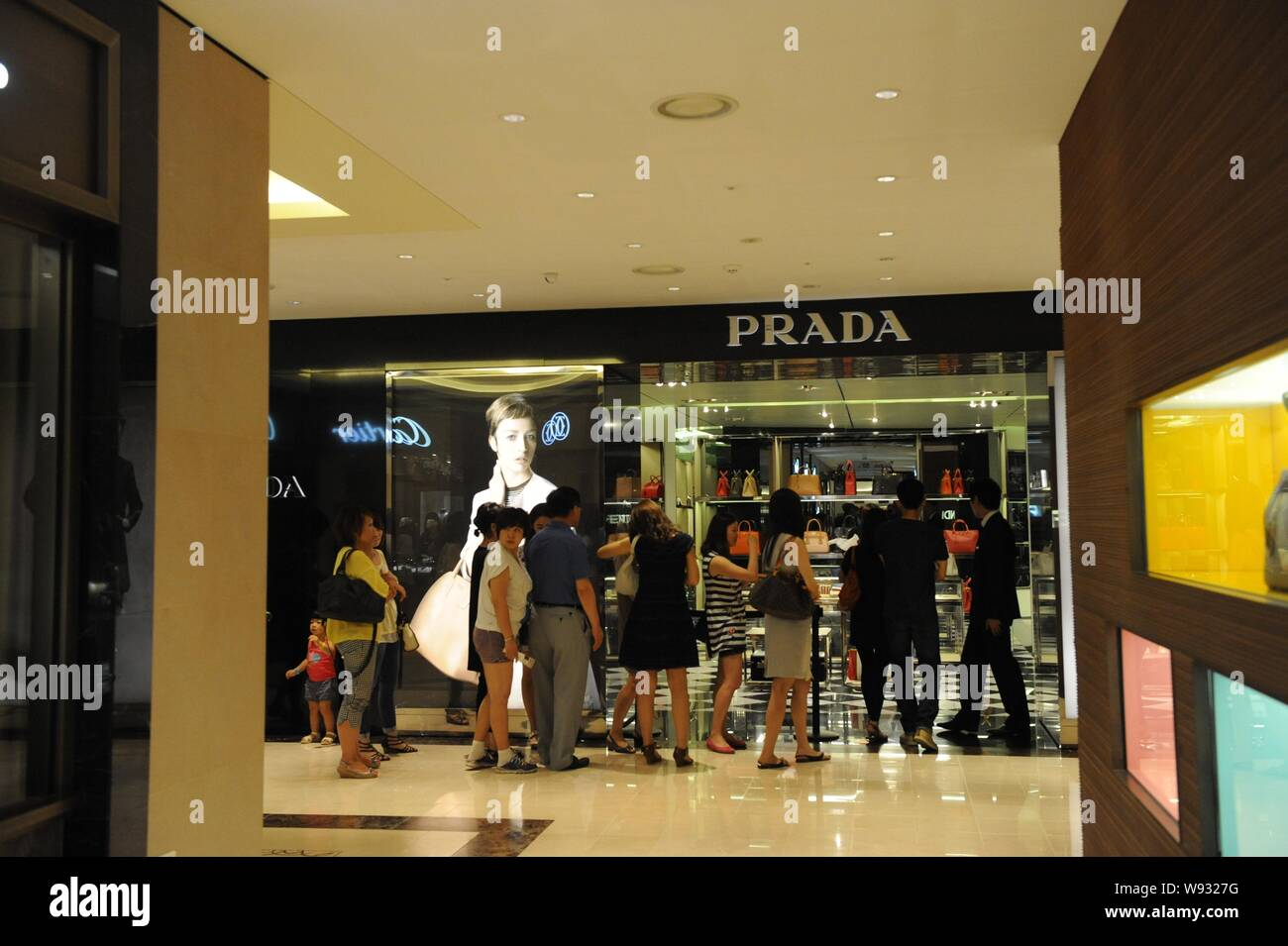 --FILE--Customers queue up in front of a Prada store at the Shilla Duty Free Shop in Seoul, South Korea, 7 July 2013.   Prada, Italys luxury goods pow Stock Photo