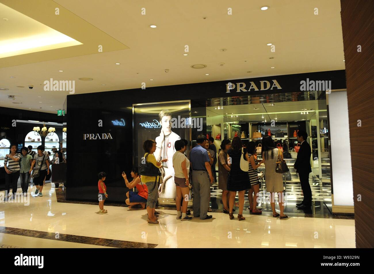 --FILE--Customers queue up in front of a Prada store at the Shilla Duty Free Shop in Seoul, South Korea, 7 July 2013.   Prada SpA, an Italian maker of Stock Photo