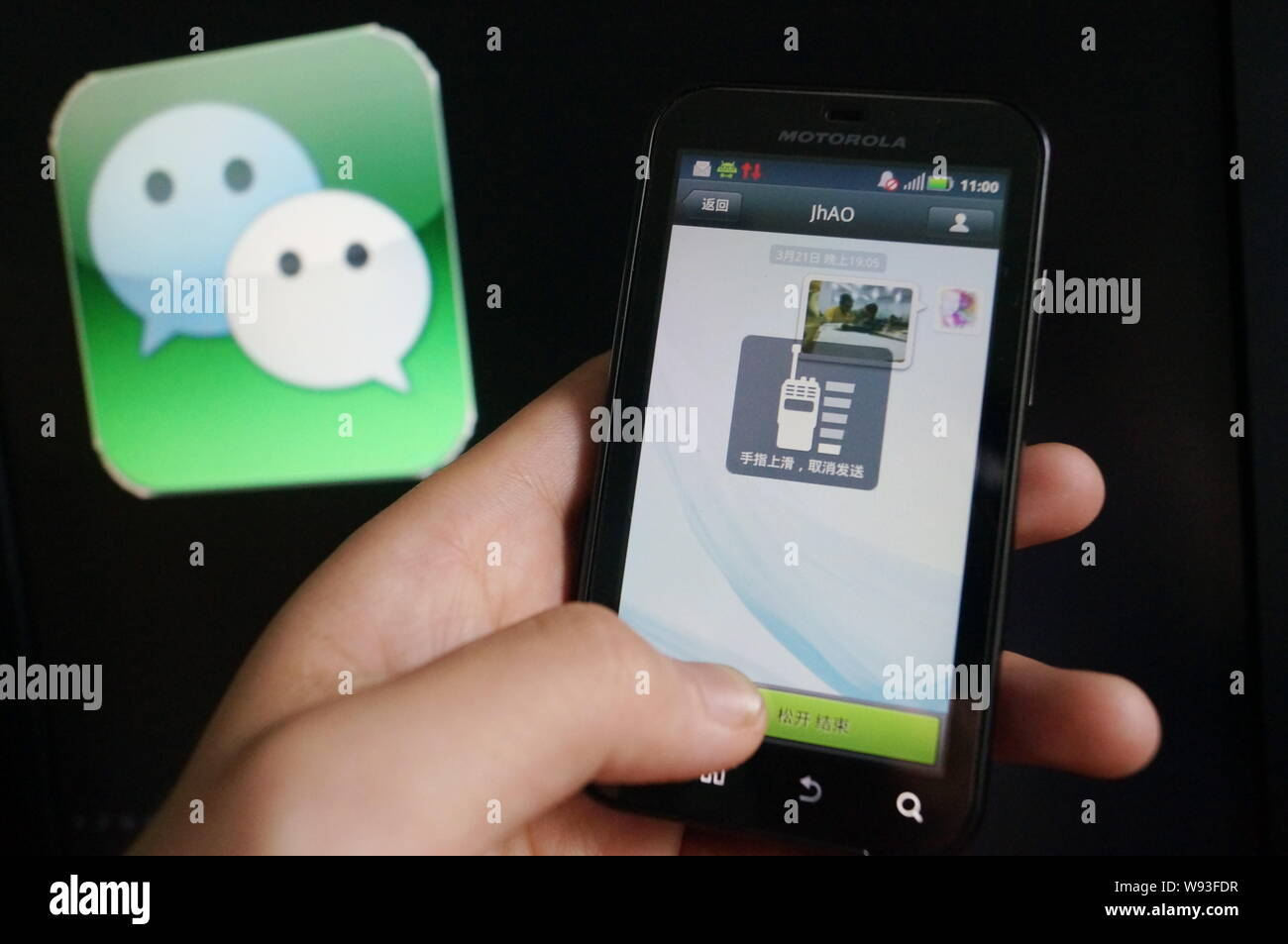 FILE--A Chinese mobile phone user uses mobile messaging app
