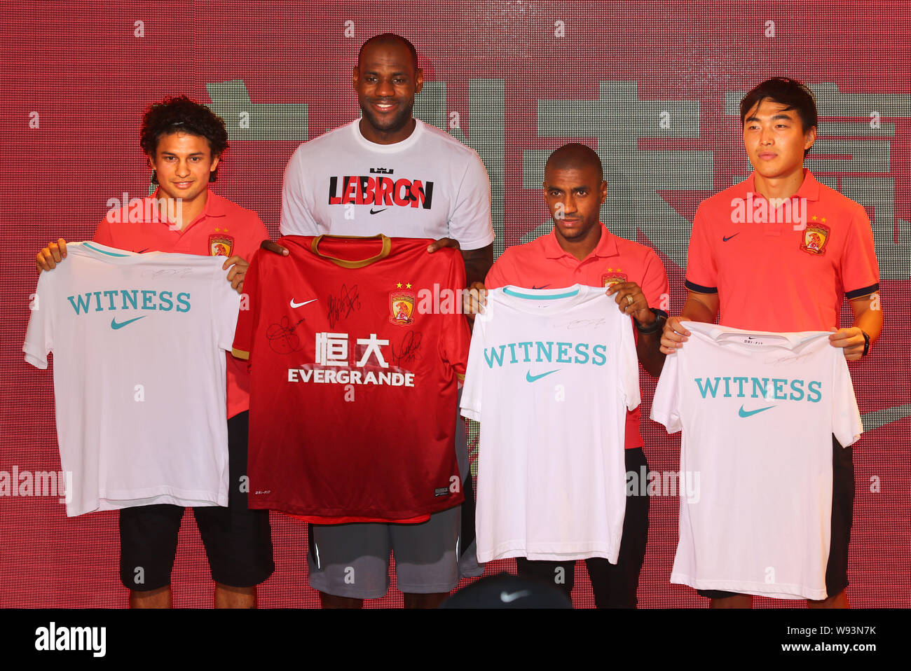 outlet store 0b56d 24642 NBA superstar LeBron James, second left, holds a team jersey ...