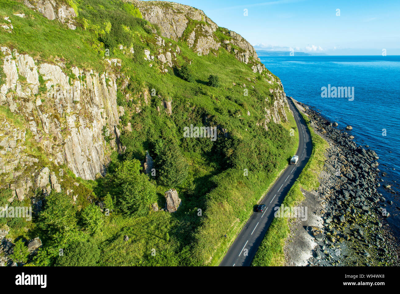 Northern Ireland, UK. Antrim Coast Road a.k.a Causeway Coastal Route near Ballygalley Head and resort. One of the most scenic coastal roads in Europe. Stock Photo