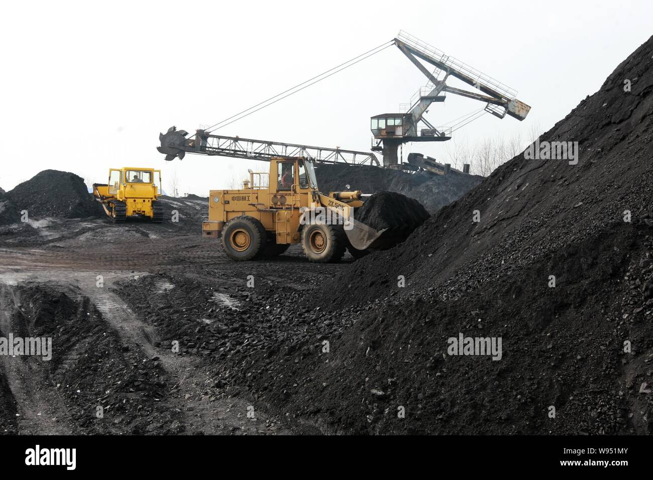 --File--Coal is transported by scrapers at a mine in Huaibei, east Chinas Anhui province, 5 December 2011.   China, the worlds biggest user and produc Stock Photo