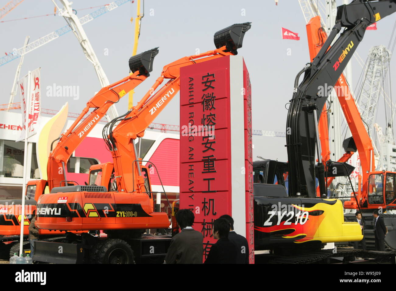 FILE--Visitors look at the machines of Anhui Rongan Heavy