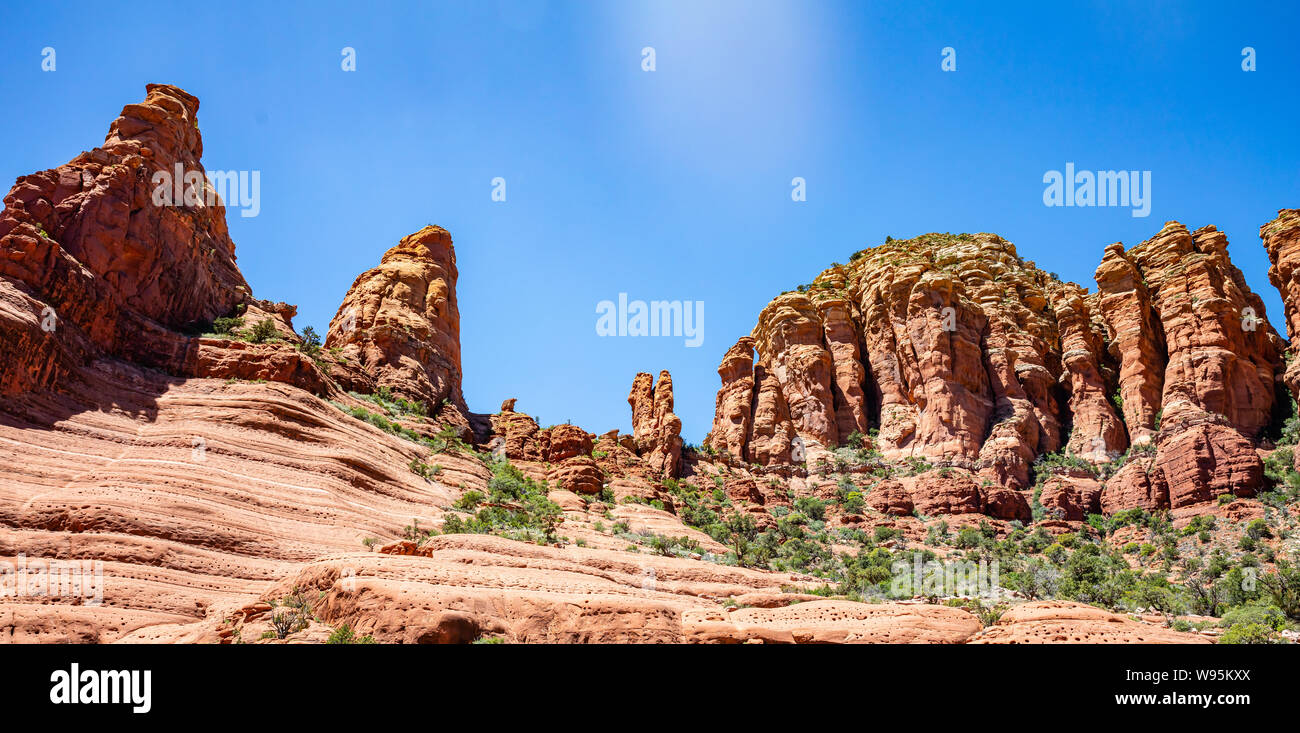 Sedona Arizona southwest US of America. Red orange color rock formations, desert sandstone landscape, clear blue sky, sunny spring day Stock Photo