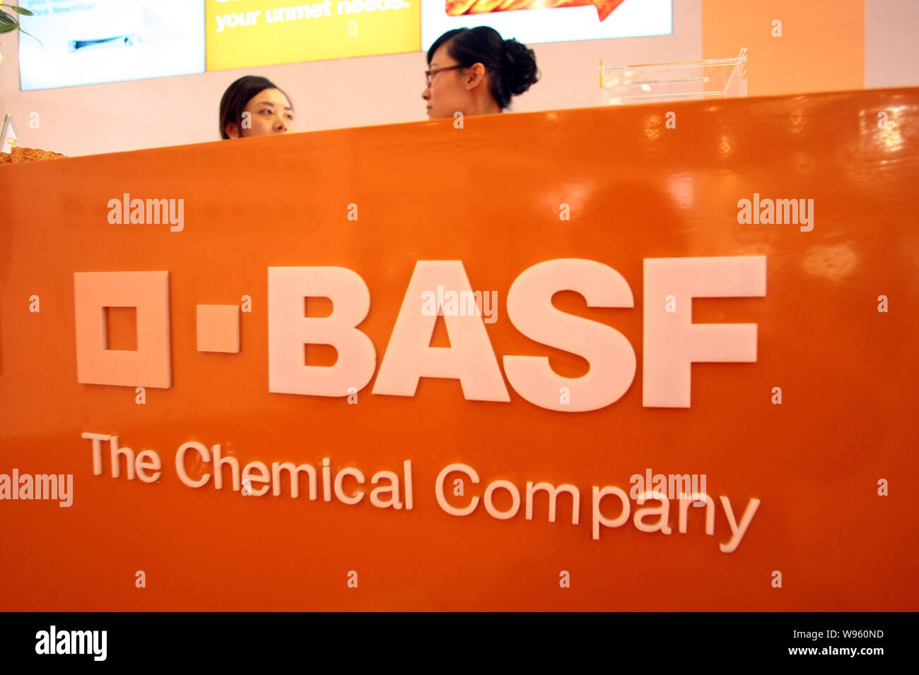 File--Chinese staff are seen at the stand of BASF during a