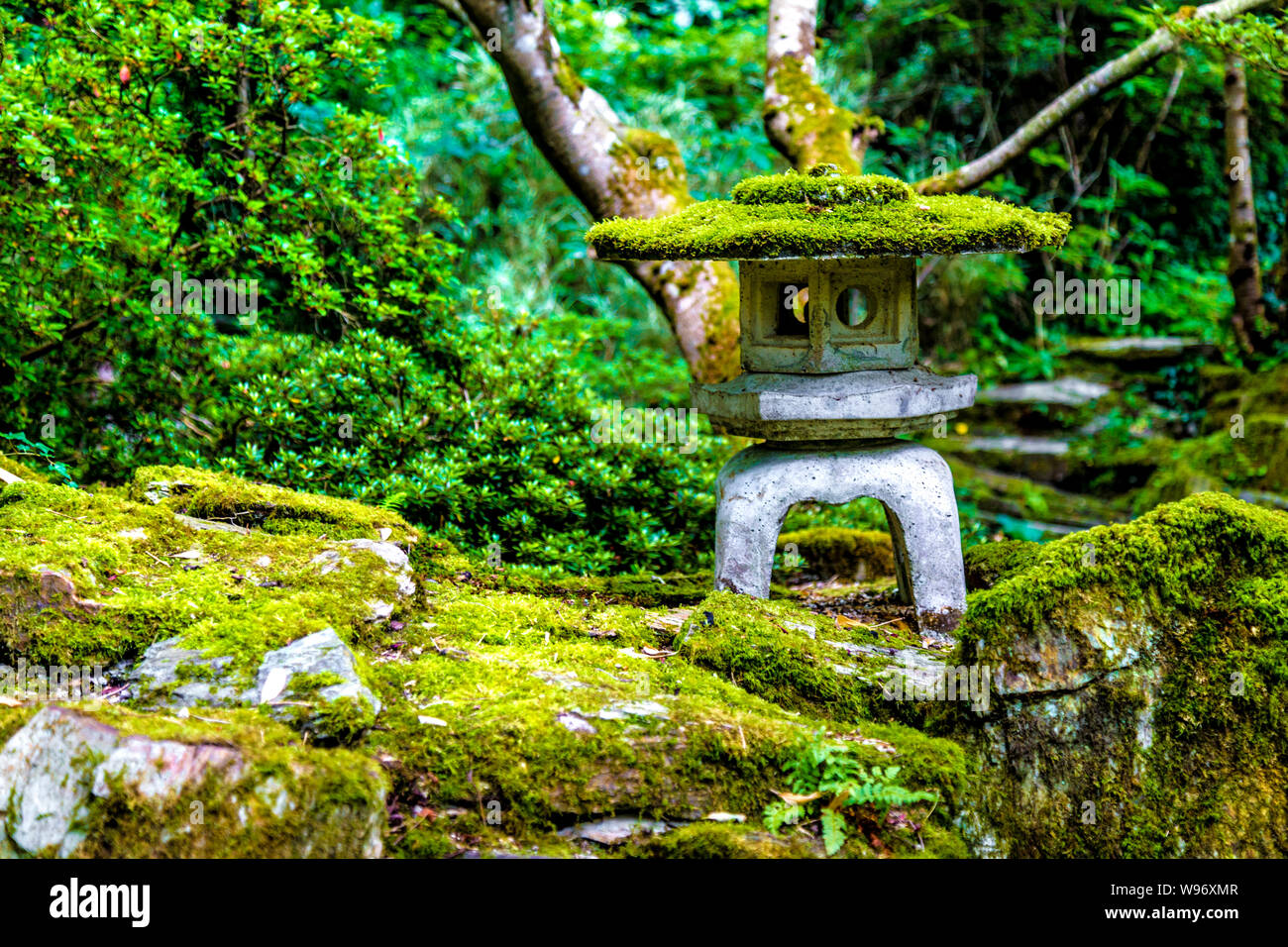 Stone Lantern Covered With Moss At The Japanese Garden In St