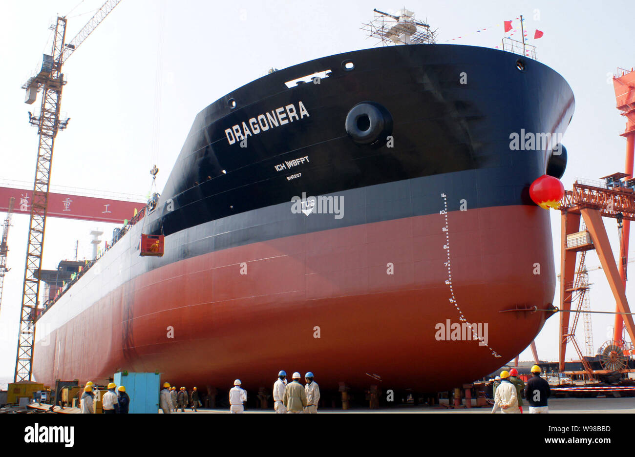 --FILE--Workers look at a bulk cargo ship to be launched at the shipyard of DDHI (Daedong Heavy Industry) in Qidong city, east Chinas Jiangsu province Stock Photo