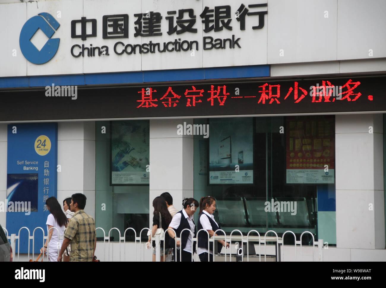 Design Bank Cor.File Pedestrians Walk Past A Branch Of China Construction Bank