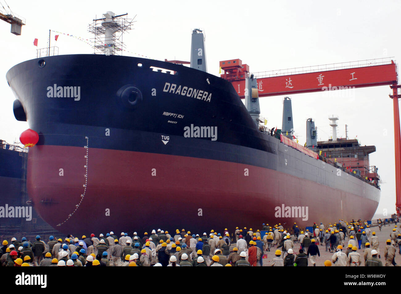 --FILE--Workers watch the launch of a bulk cargo ship at the shipyard of DDHI (Daedong Heavy Industry) in Qidong city, east Chinas Jiangsu province, 5 Stock Photo